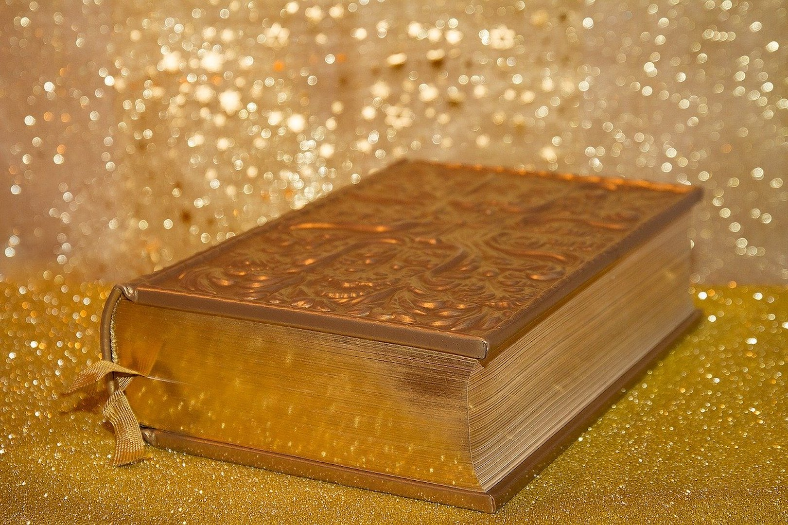 Image of gold bible that is closed